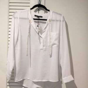 White blouse with gold details